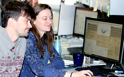 Two graduate students from the Smith lab work on identification of proteoforms.