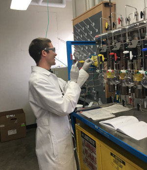 Graduate student Steven Chapman works in the lab.