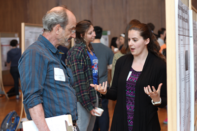 Chemical biology Professor Lloyd Smith talks to a grad student