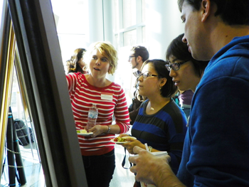 Graduate students talk about their research at a poster session
