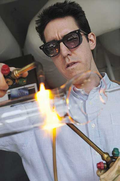 Master glassblower Tracy Drier, photo by Jeff Miller