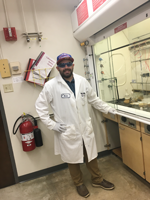 Graduate Student Kevin Garcia works in his research lab.
