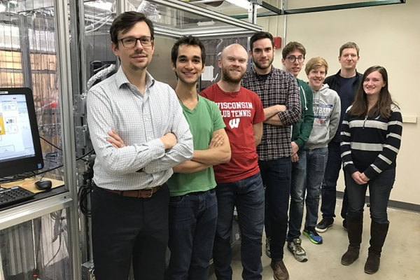Eight of the coauthors of a new Science study detailing a boron nitride family of catalysts are shown in a gas-phase research laboratory.