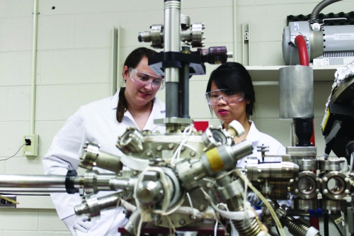 Graduate students Arielle Mensch and Mimi Hang conduct chemistry research as part of the Center for Sustainable Nanotechnology