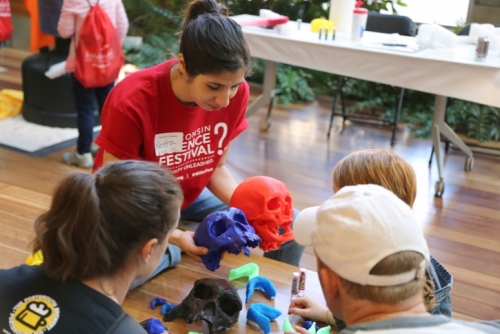 Kids visit a table at the Discovery Expo at the WIsconsin Science Festival