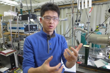 Graduate student Yue Qiu stands in an Ediger Group research laboratory