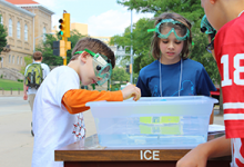 Campers test out solar-powered boats at ChemCamp